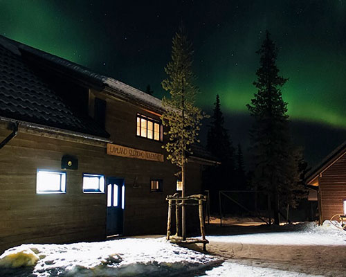 Northern Lights over a building in Sweden