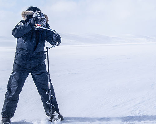 Boring an ice fishing hole
