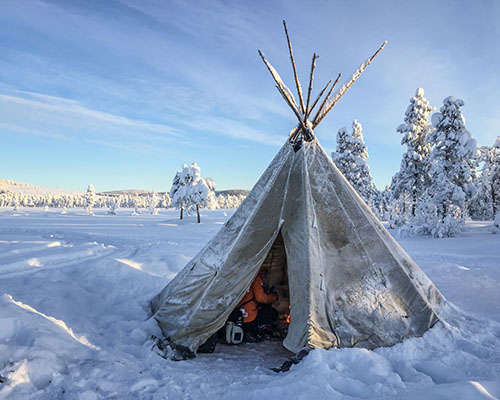 Our traditional Sami Lavvu tent on a frozen river