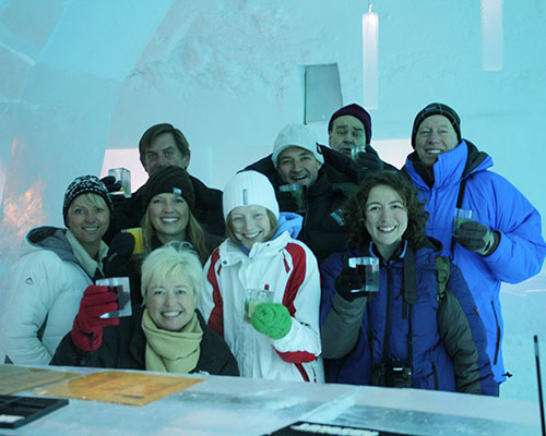 People at the Ice Hotel bar with ice glass shots