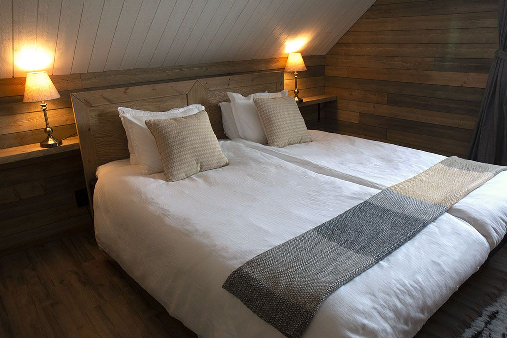 Bedrooms can be doubles view of bed