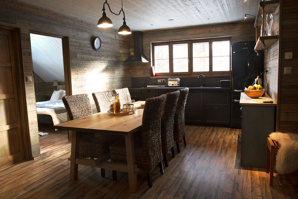 Lapland Sleddog Adventures Guest Lodge view of dinning table for eight people