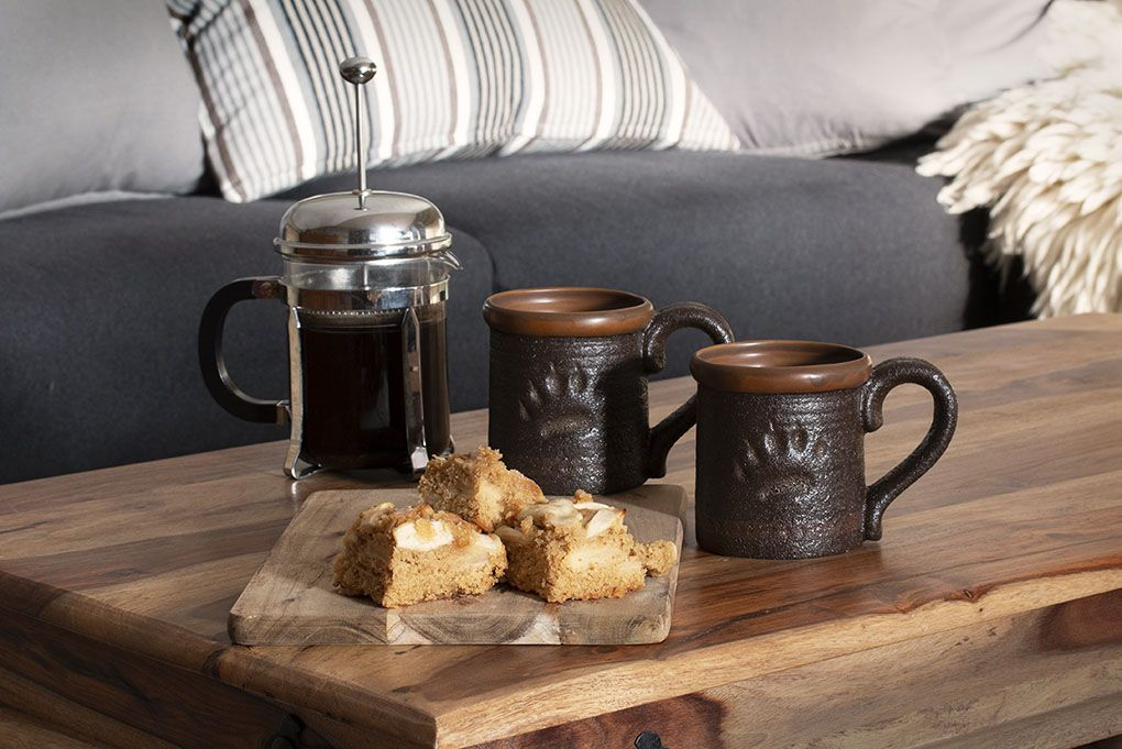 Lapland Sleddog Adventures guest lodge - fresh coffee and homemade cake on a coffee table