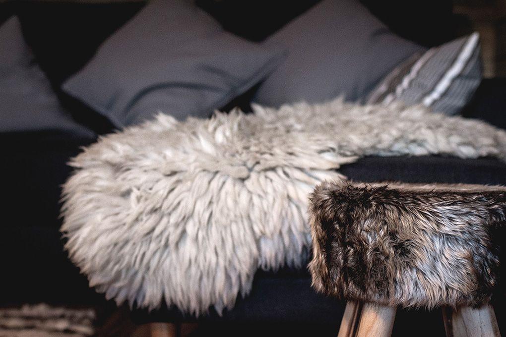 Lapland Sleddog Adventures guest lodge - lounge close up of stool